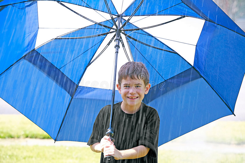 Boy In The Rain Stock Photos
