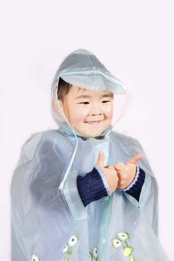 Boy in raincoat stock images