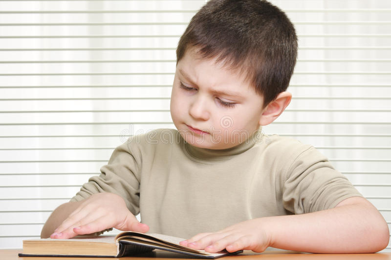 Download Boy reading book stock image. Image of concentrated, caucasian - 13626023