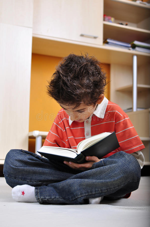 Download Boy reading a book stock image. Image of pleasant, educational - 16107547