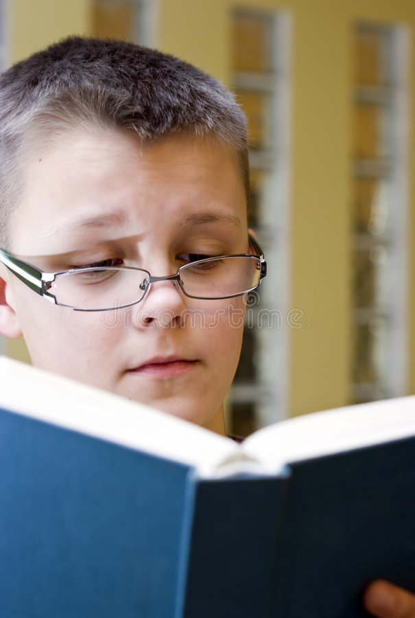 Download Boy reading book stock photo. Image of youthful, reads - 4712406