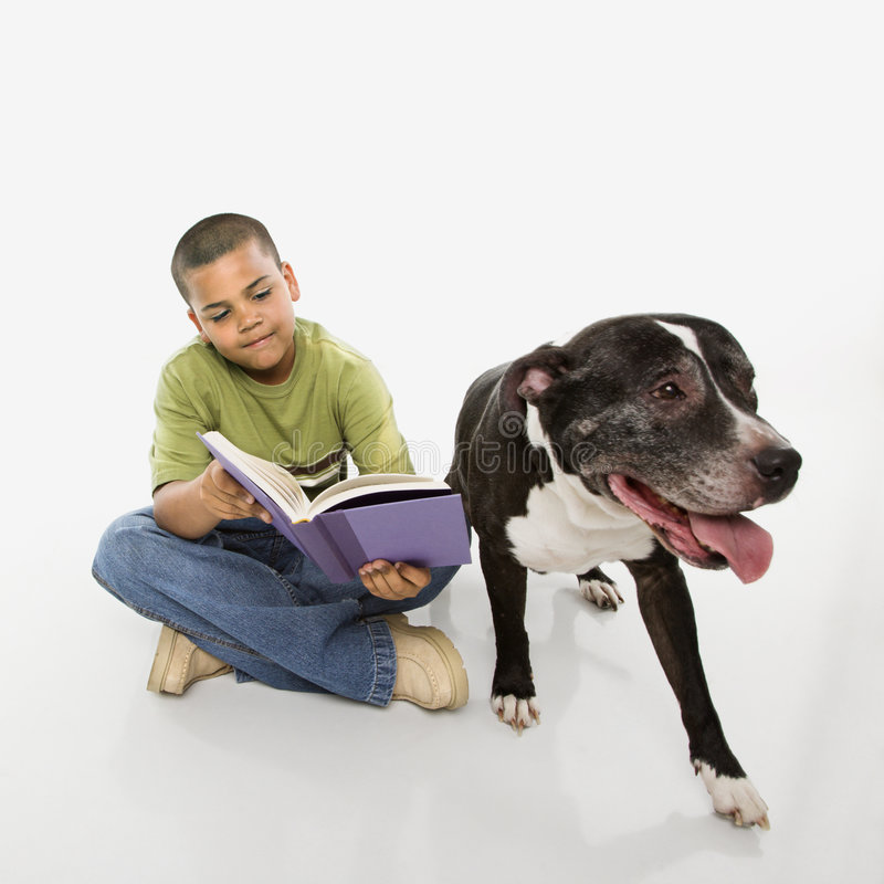 Download Boy reading book with dog. stock photo. Image of studio - 5538610