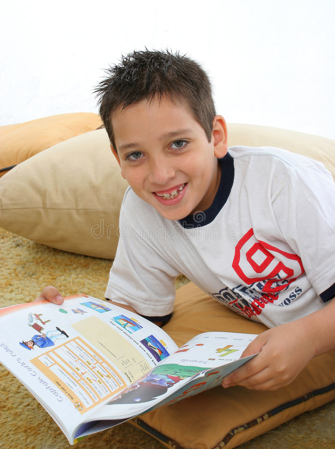 Download Boy Reading A Book On The Floor Stock Photo - Image: 728352