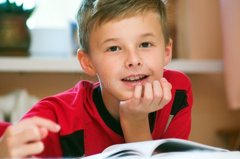 Boy reading book portrait stock photo