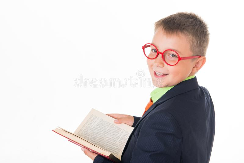 Boy reading a book thirsty for knowledge - isolated over a white background.  royalty free stock photography