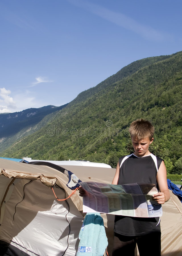 Boy reading map stock images