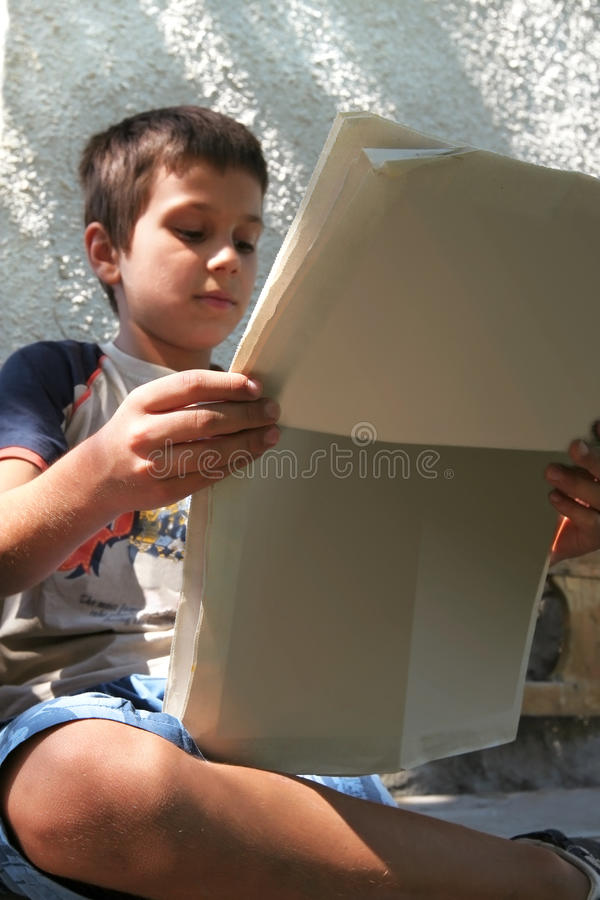 Boy Reads the Morning News royalty free stock image