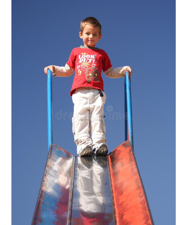 Boy ready for slide stock images