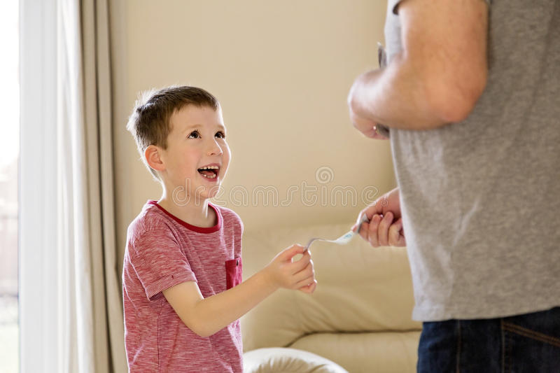Boy receiving pocket money (allowance) from father royalty free stock photos