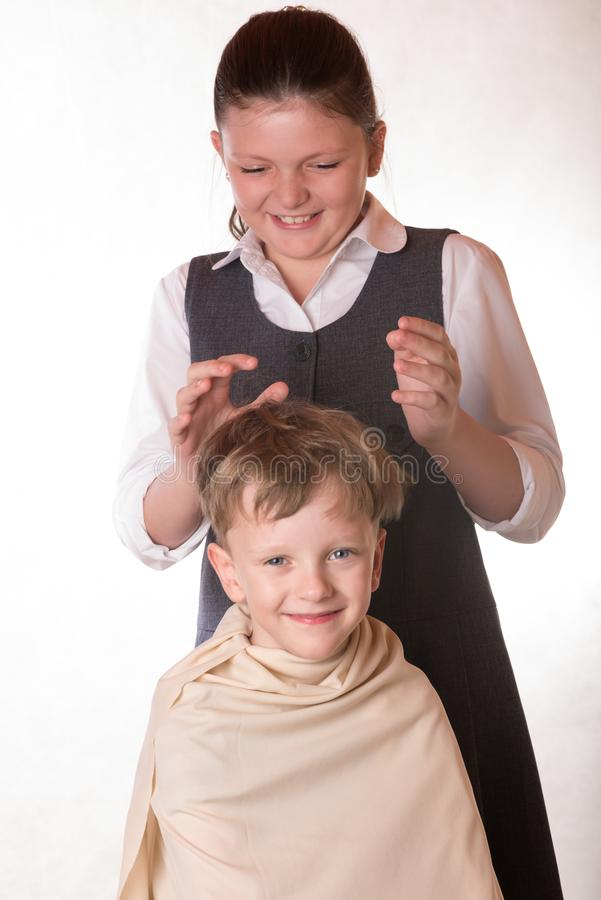 Boy at a reception at the barber. A young man visits the salon o royalty free stock images
