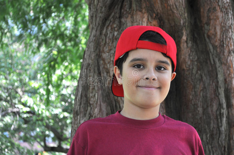 Download Boy in Red stock photo. Image of outside, tree, casual - 26137424