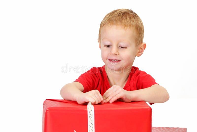 Boy red gift stock photos