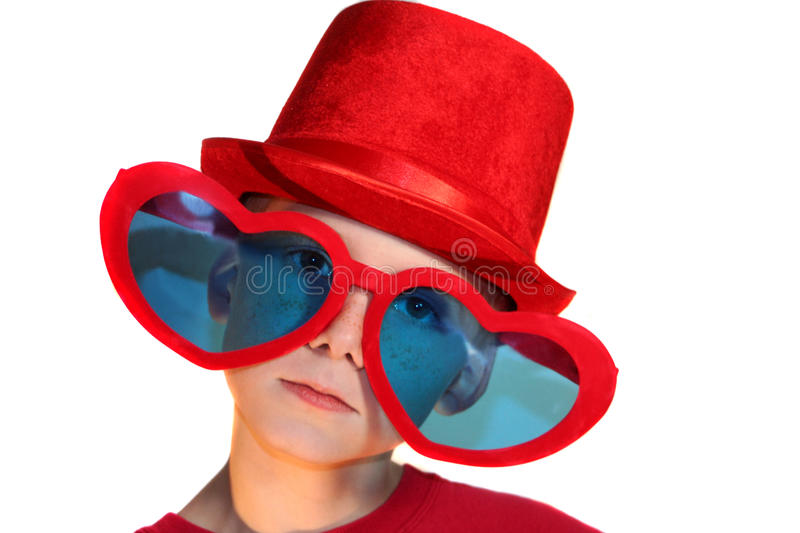 Download Boy In Red Hat And Heart Glasses Horizontal Stock Image - Image of conceptual, alone: 26137239