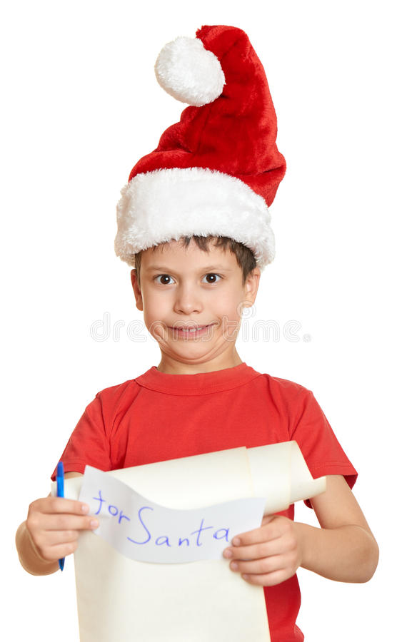Boy in red hat with long scroll letter with wishes to santa stock photography