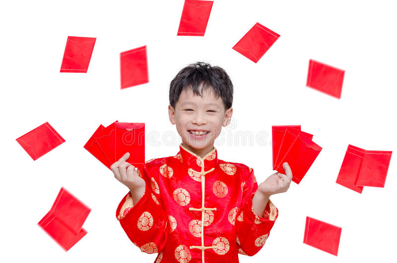 Boy with red packet money. Young Asian boy with red packet money over white stock photos