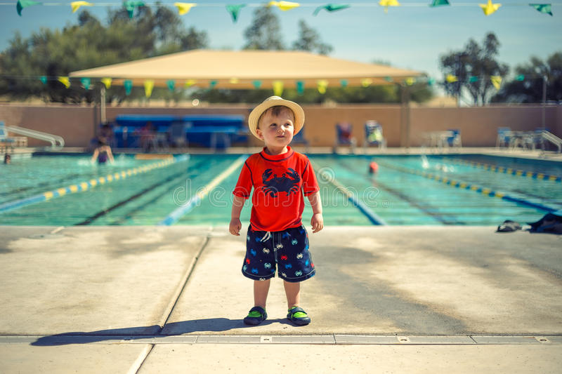 Boy On Red Shirt Beside Swimming Pool During Daytime Free Public Domain Cc0 Image