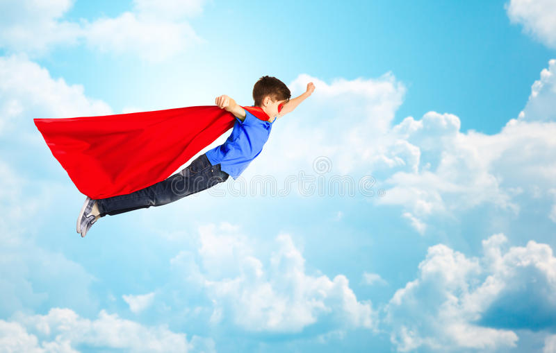 Boy in red superhero cape and mask flying over sky stock image download boy in red superhero cape and mask flying over sky stock image image of publicscrutiny Images
