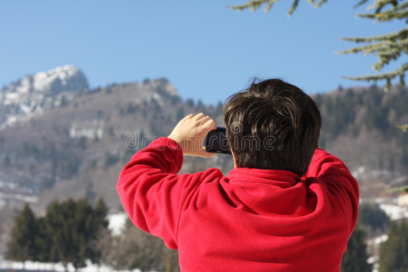 Boy In Red Sweater That He Photographed The Summit Of A Mountain Stock Image