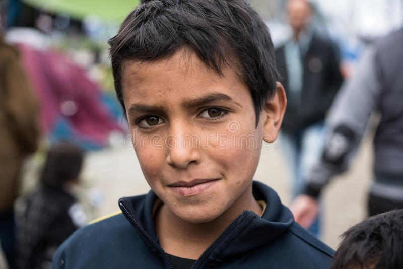 Boy in refugee camp in Greece stock photos