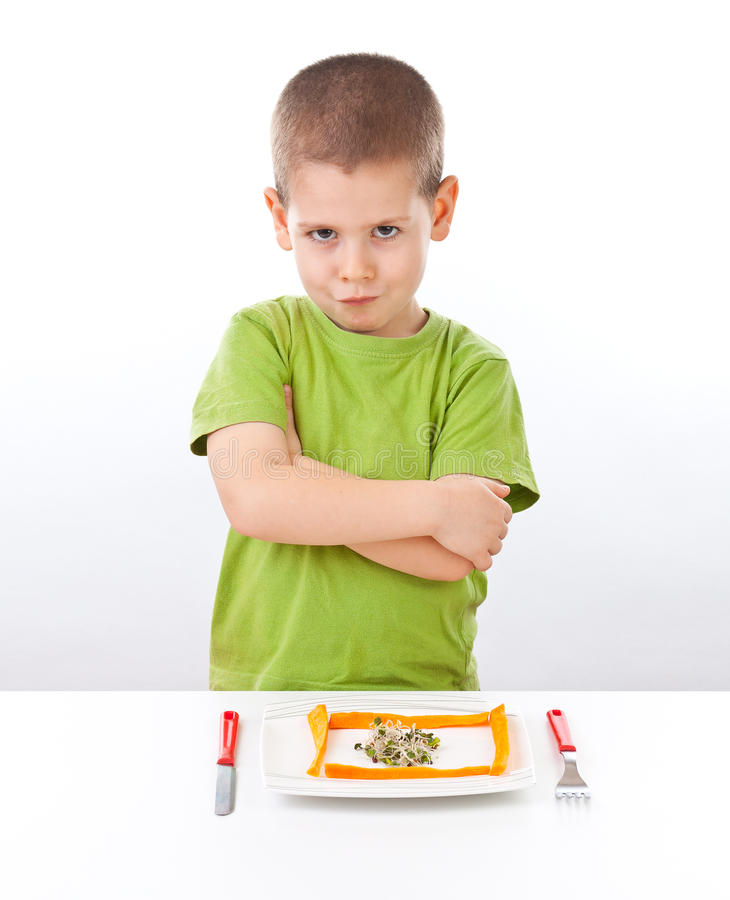 Boy refuses to eating. Healthy food stock photo