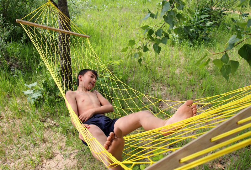 Download Boy Relaxing In Hammock Stock Images - Image: 14685524