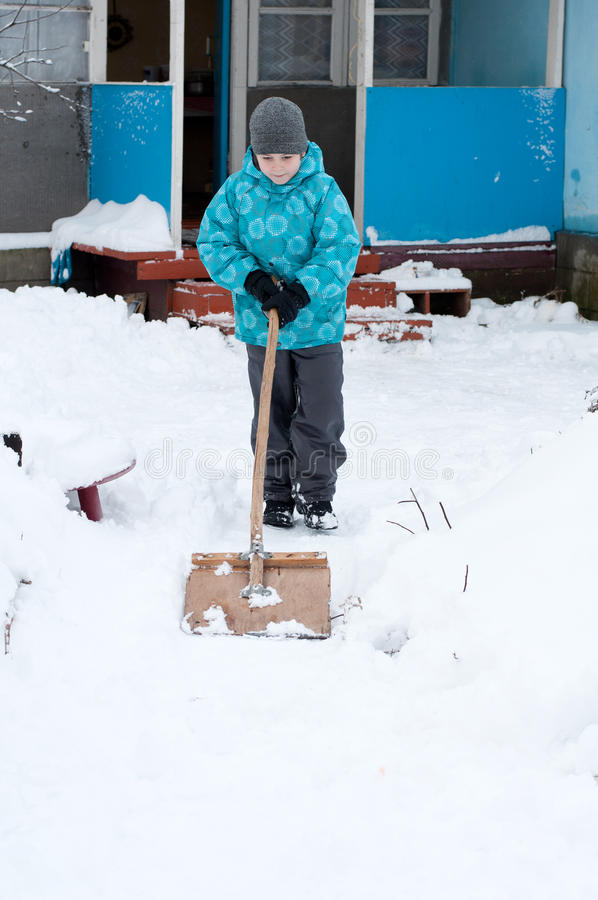 Boy Removes Snow Stock Images