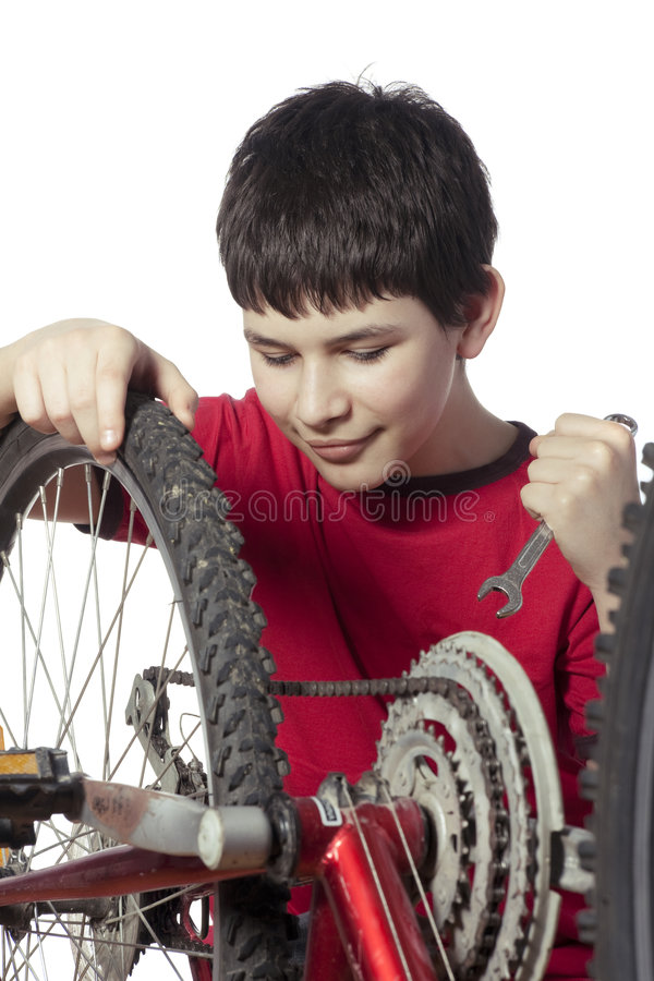 Download Boy repairing the bicycle stock photo. Image of dirty - 8760982