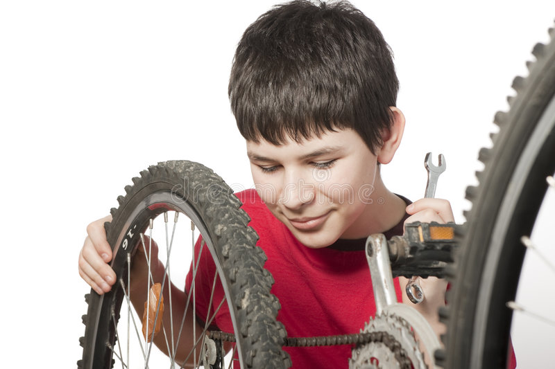 Boy repairing the bicycle royalty free stock photos