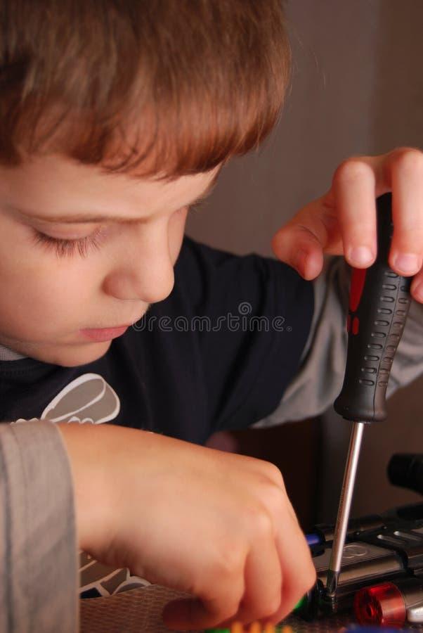 Boy repairing toys. stock photography