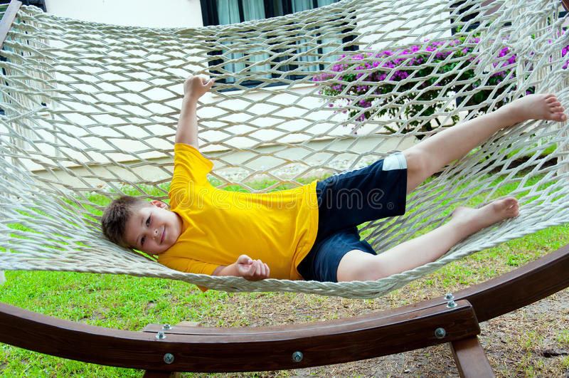 Download Boy Resting In  Hammock Stock Images - Image: 26571794