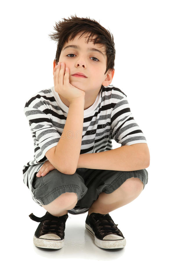 Boy Resting with Watching Expression. Boy with chin resting on hand with watching expression over white stock images