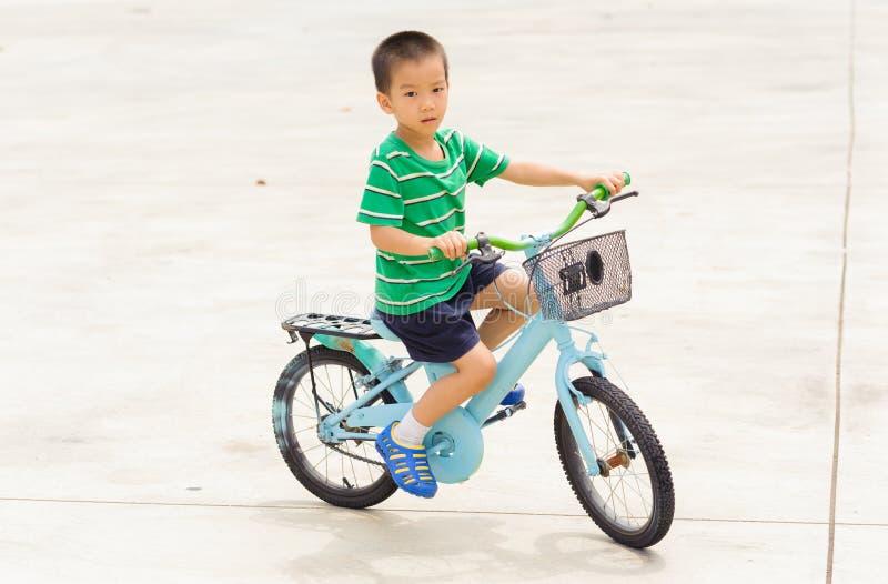 Boy ride bicycle stock photo