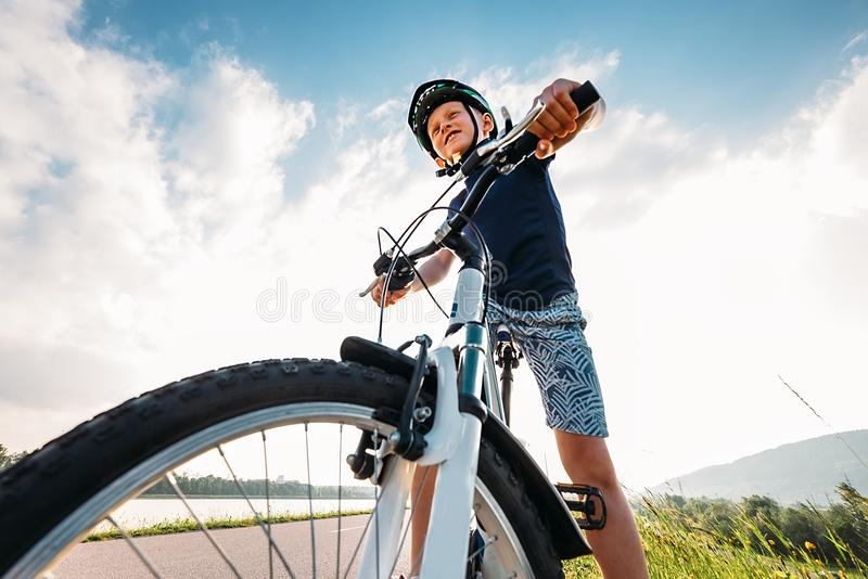 Boy ride a bicycle royalty free stock photography