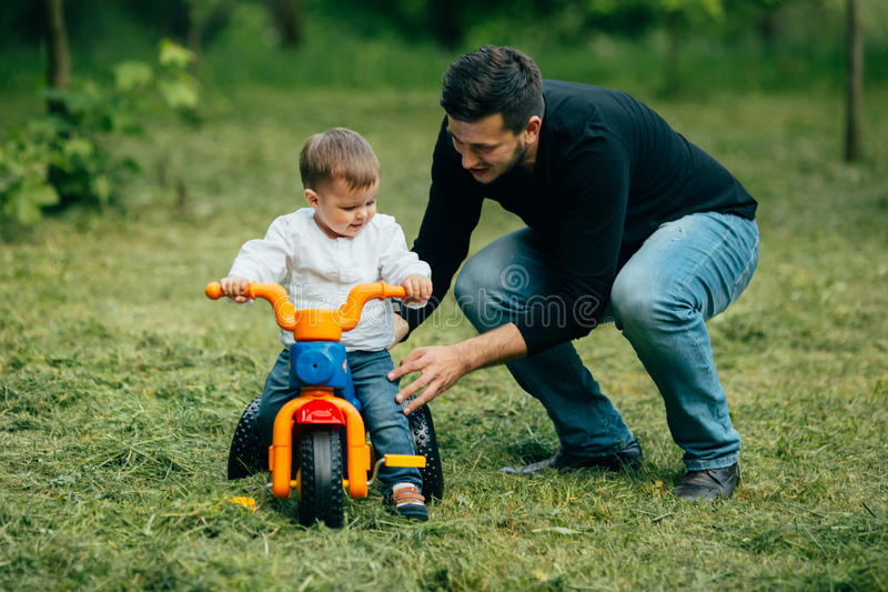 Boy ride first time on a bicycle outdoors royalty free stock photography