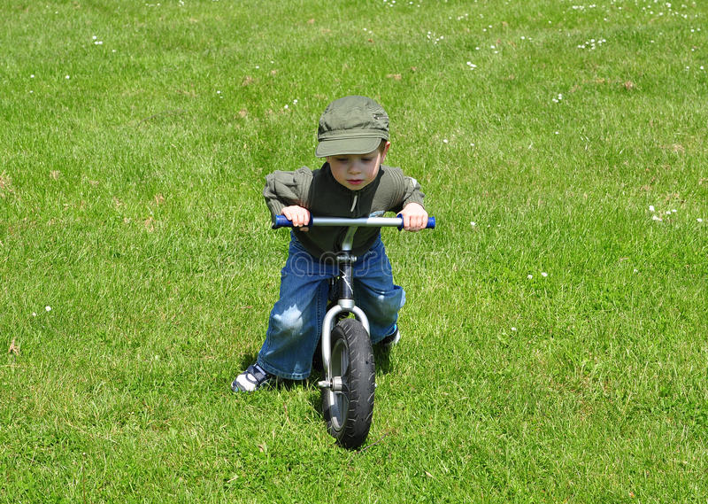 Download Boy ridig a bike. stock photo. Image of bike, youth, laufrad - 25468652