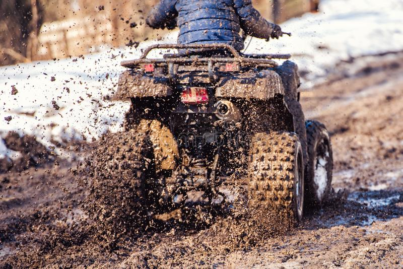 The boy is riding an ATV off-road royalty free stock photos