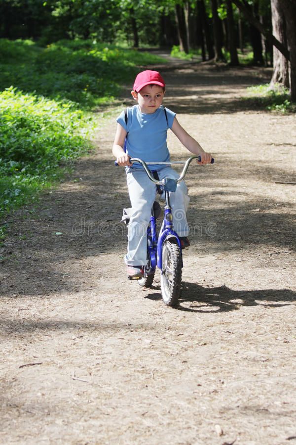 Download Boy riding bicycle stock image. Image of summer, bicycle - 14416459