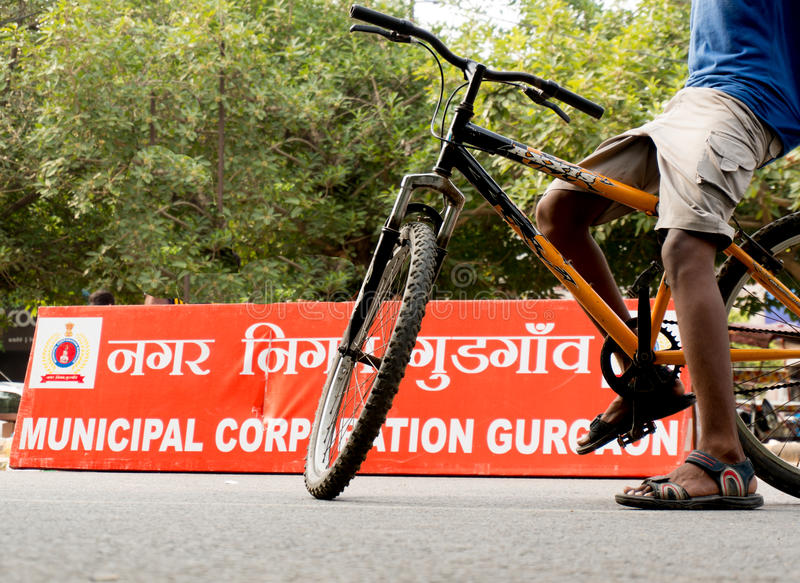 Download Boy Riding Bicycle In Front Of MCG Board Editorial Image - Image: 43434910