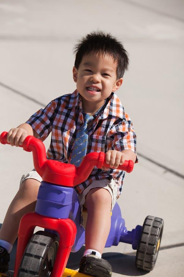 Boy riding a bike stock images