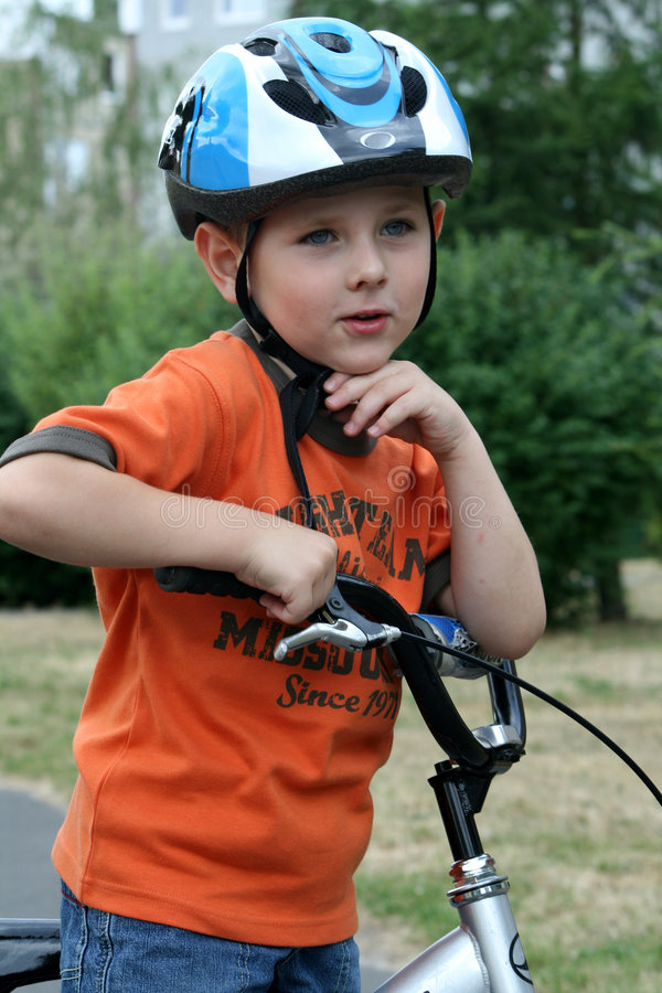 Boy riding bike stock photos