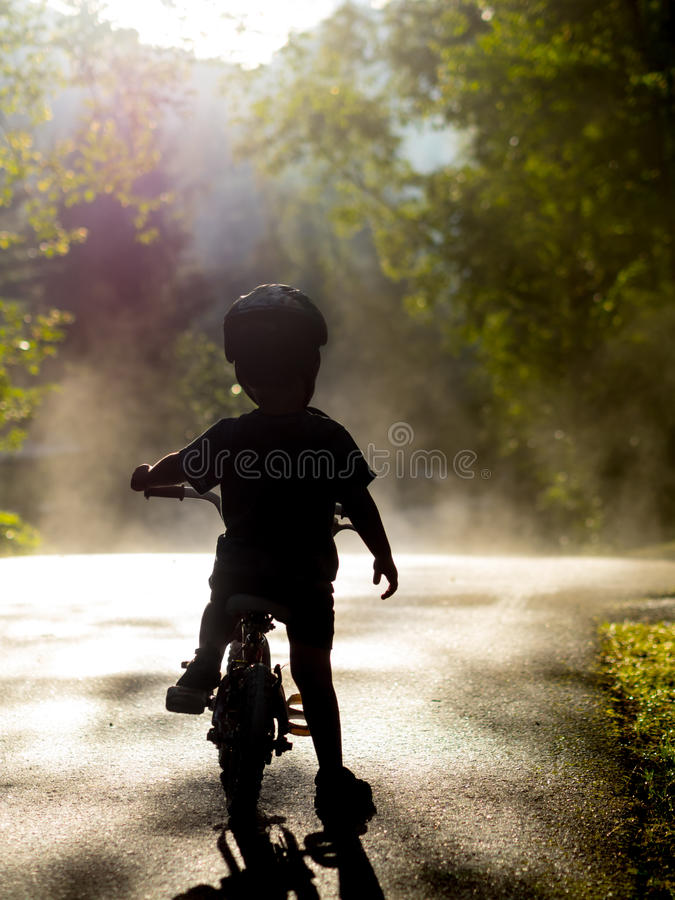 Download Boy riding bike in mist stock photo. Image of youth, ride - 42205356