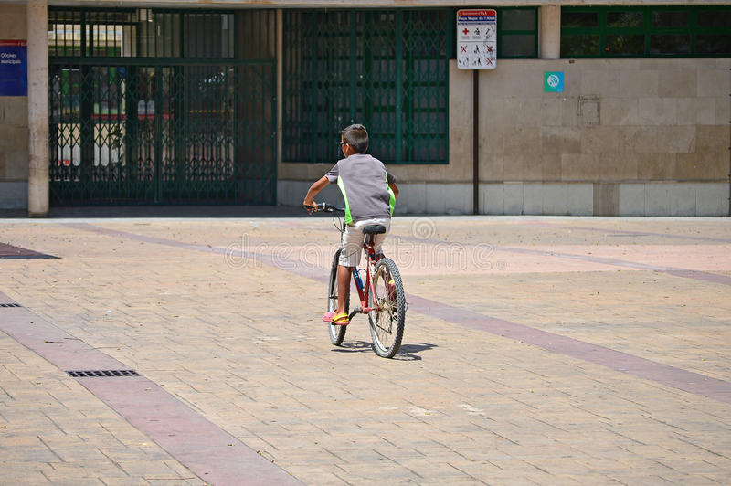 Boy Riding A Bike royalty free stock photos