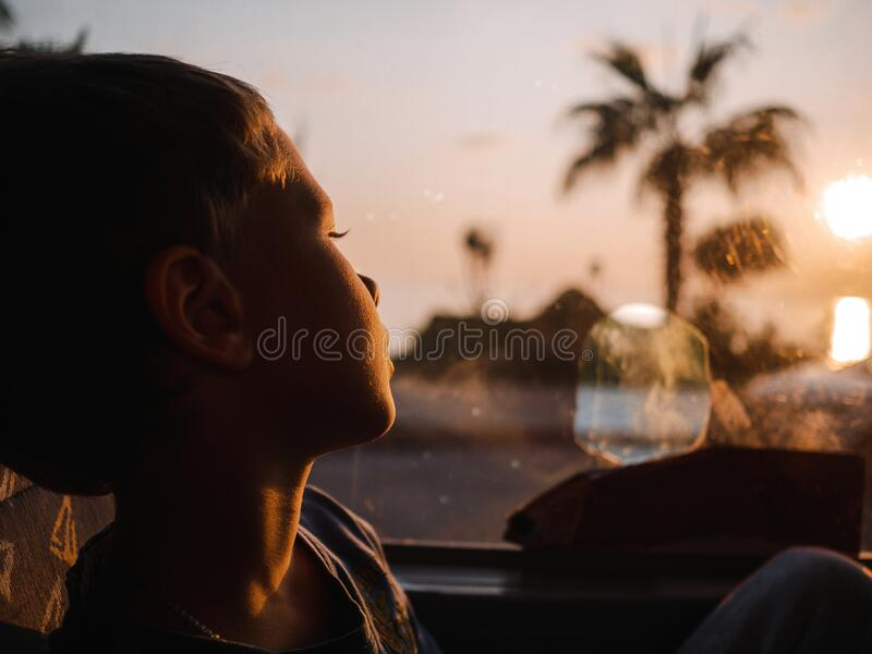 Boy riding in the bus against the sunset. Turkey stock images