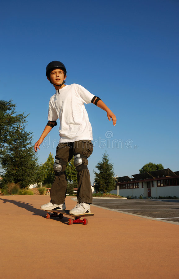 Boy Riding a Skateboard stock images