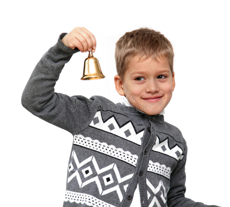 Boy ringing the bell. Smiling boy ringing the bell in a class primary school isolated on a white background stock photos