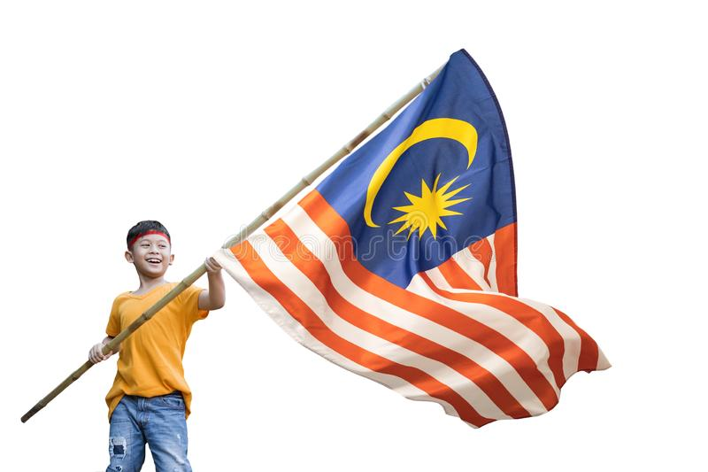 Boy rising malaysian flag with pride. In front of his house stock photos