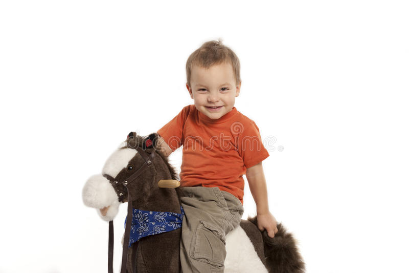 Boy and rocking horse stock images