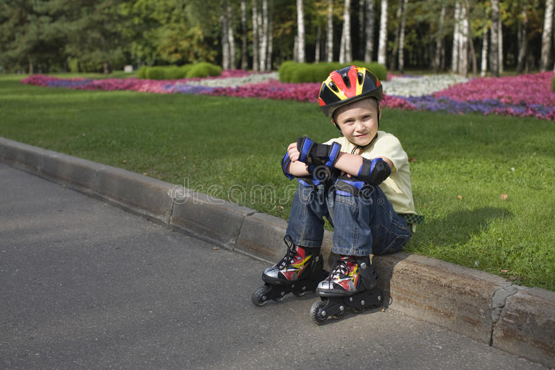 Download The Boy On The Roller Blades Royalty Free Stock Images - Image: 10960609