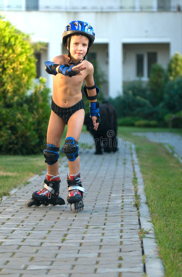 Boy Roller-Blading. The boy goes for a drive on roller skates sidewalk royalty free stock photos