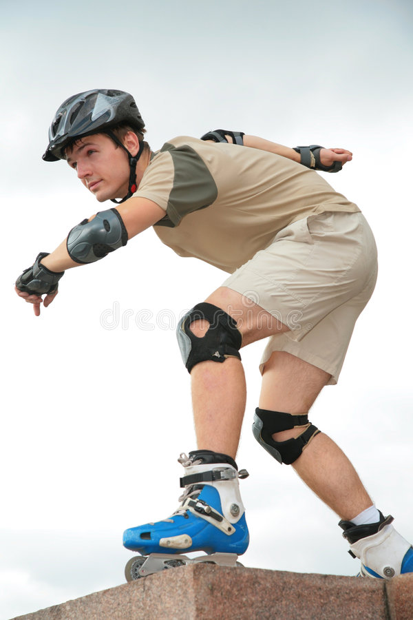 Boy On Rollerblades In Starting Position Royalty Free Stock Photos